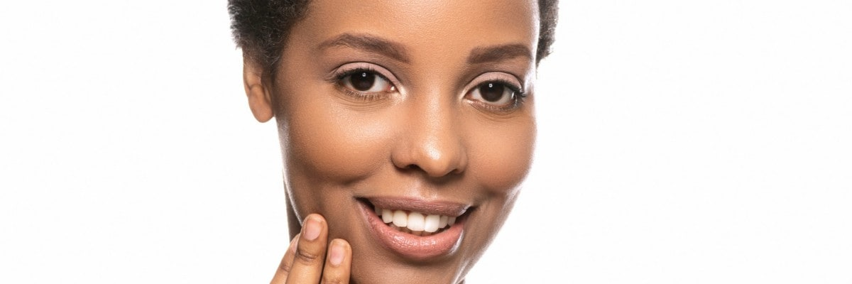 Photo of African woman with clean healthy skin on white background