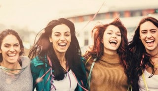 Four happy friends with long brown and red hair for Sunsilk's Hair Type page.