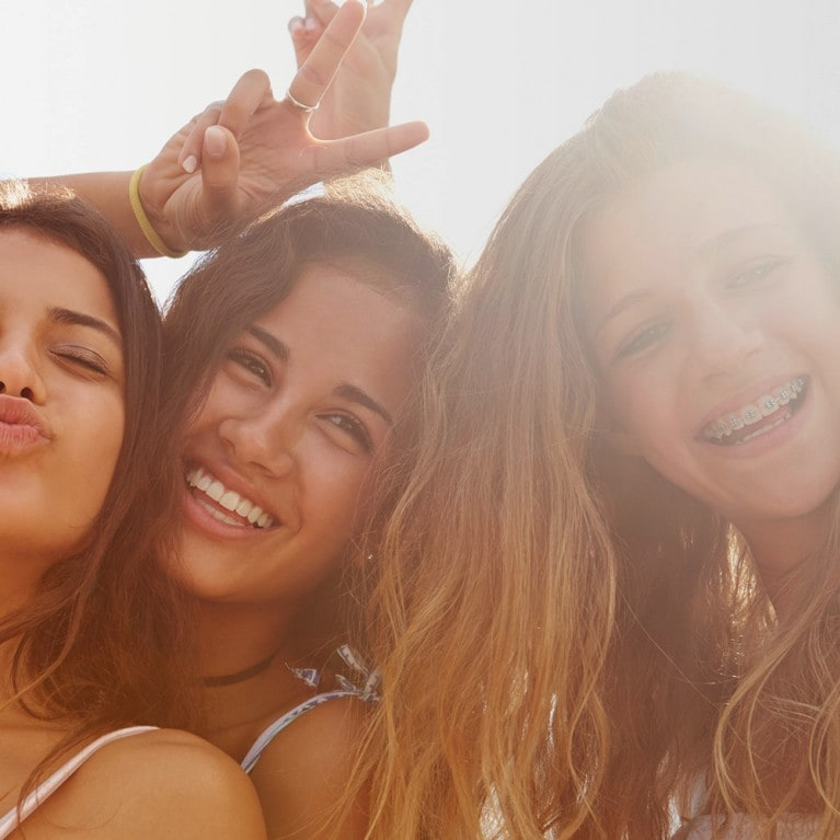 Three girls taking selfie
