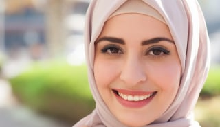 Beautiful smile of a veiled girl