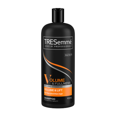 A 900ml bottle of TRESemmé Volume & Fullness Shampoo front of pack image