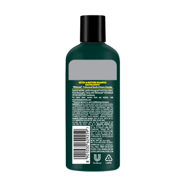 A 80ml bottle of Tresemme Botanique Detox & Restore Shampoo back of pack image